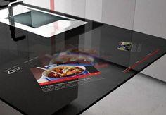 Italienische Küchen Designer haben mit der Prisma Smart Kitchen eine Hightech Küche entworfen, die das Potenzial zur Küche der Zukunft hat. Die Designer des Küche Design Unternehmens Toncelli haben unter Verwendung eines Touchscreens und verschiedener Glas Elemente eine Küche designt, die wirkt, als wäre sie für den täglichen Gebrauch bestimmt. Von den Designern wurde auf der einen Seite des Küchenblocks die Samsung Galaxy Tab Technologie in die Arbeitsfläche integriert.