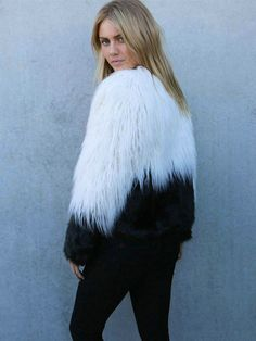 Cozy up in this gorgeous heavyweight faux fur jacket with an eye-catching two-tone mashup. Lined. Small front loop button. - 64% Modacrylic - 36% Acrylic - 100% Polyester Backing - Dry Clean - Import
