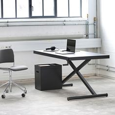 For the Growing Standing Desk Trend, Homlris's Height-Adjustable XTable: Danish furniture company Holmris has just released the height-adjustable XTable.