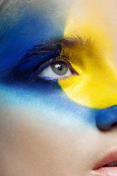 Model Angelina Betsivu makeup in blue and yellow