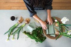 """Joanna Gains - """"I created this arrangement with floral foam and moss from the local craft store, and a wooden serving bowl from my cupboard. I stuck the floral stem into the foam, left the bulb exposed, and covered the foam with moss. These are perfect for an entryway, dining table centerpiece, or coffee table."""""""