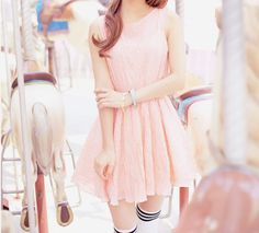 A lovely soft pink dress with cute stripped stockings to match.