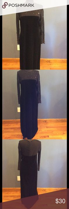 Beautiful velvet like dress Sheer top and long sleeves with sequence. 90% polyester and 10% spandex. Zipper back in great condition. Size is 14 p but not sure what makes it a P because I am was always a 14 regular and length is the same as my other dresses. Dresses