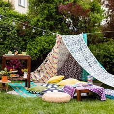 Go glamping in your own backyard with these easy tips + tricks using IKEA string lights, colorful pillows, snacks + more! #partner