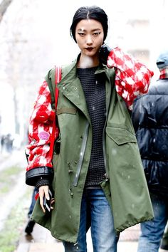 Design Inspiration | Cute meets Grunge | simple contrast plaid fabric sleeves embellished with sew-on embroidered decals and attached to army jacket body | pretty cool!