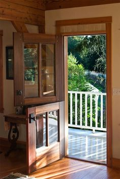 Dutch Door - Let in the breeze but not the horses! I have always wanted a dutch door in my home . Back Doors, Entry Doors, Entrance, Wood Doors, Style At Home, Future House, My House, House Front, Traditional Front Doors