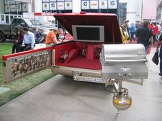 STRANGE SPORTS EVENTS - EXTREME TAILGATING EQUIPMENT AND TRUCKS - SWING OUT GRILL - TAILGATE HOLDS SAUCES AND BBQ TOOLS - TV
