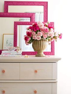To get this look, spray-paint a collection of mismatched frames. Choose all one shade or hang a variety of hues together.