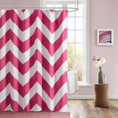 The Mizone Libra shower curtain gives you an updated modern look. The overscaled chevron design features pink and white colors printed on polyester microfiber for easy care.