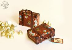 On popular demand, heres a printable well-travelled suitcase in a realistic brown leather finish, complete with luggage tag! Use it to store your business cards, knick-knacks or use as party favor boxes. This DIY paper template is lovingly illustrated with intricate details. It's very easy to make, with just scissors and glue. Dress up your gifts or holiday goodies in this special package. Ready-to-print on an A4 or Letter size printer. Both A4 and Letter sizes are included. ASSEMBLY…