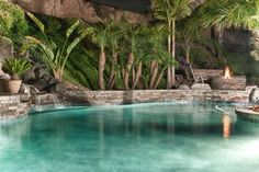 pool .. waterfall .. fire pit ... tropical landscape