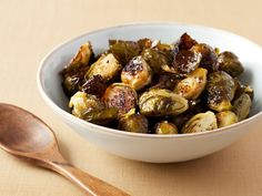 Roasted Brussels Sprouts Recipe : Ina Garten : Food Network ~ These are totally different from boiled brussel sprouts; these are actually DELICIOUS! Healthy Recipes, Vegetable Recipes, Cooking Recipes, Healthy Meals, Healthy Sides, Chef Recipes, What's Cooking, Diabetic Recipes, Chicken Recipes