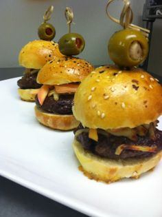 Sliders made with local organic beef, homemade pickled onions and homemade brioche buns. www.myhappygrape.com