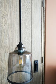 headboard lighting detail | filament lighting | concrete effect wall covering | limed timber joinery | leather upholstery | guest room design | industrial | hotel interior design | London