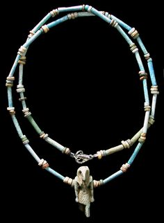 Ancient Resource (Gabriel Vandervort) | Necklace; Ancient Egypt, Late Period, 664-535 BC faience disc and tube beads. Strung with a great faience amulet of Thoth, the ibis-headed god.