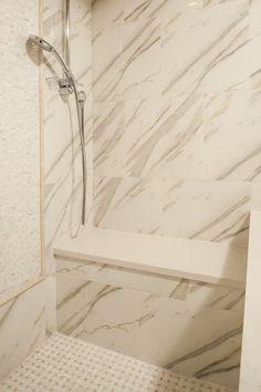 Shower bench seating with separate handheld shower, Porcelain marble tile #LongIslandBath #LongIslandLuxuryBath