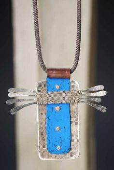 Blue Pencil Paddle Necklace by Mary Hettmansperger.