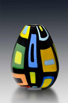 """I made this by fusing the glass for the design and then blowing the glass using a process called a """"Roll Up"""". approx 17 """" high and 8"""" at its widest"""