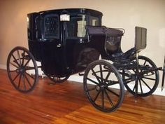 The Brougham. Enclosed carriage for four people with doors on sides, comfortable seats, glass windows, and pulled by two horses. Designed to be comfortable, private, and fast. Named after Baron Henry...