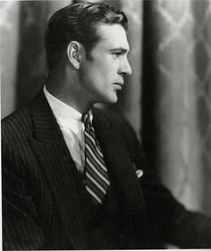Gary Cooper. Suited and booted in profile