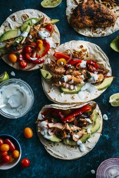 Blackened salmon fajitas topped with cajun salmon, peppers, onions, and a cilantro lime sauce--ready in under 30 minutes!