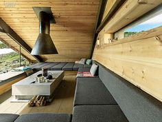 Built-in banquettes, upholstered in wool felt, double as berths for sleeping - Snøhett, Norway |