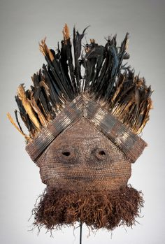 Africa | Mask from the Binji people of Congo | Woven plaited hood, abrus seeds, feathers and paint