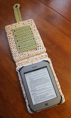 Great Kindle/Nook/eReader Flip Cover by Dawn Gillis, pattern on Ravelry only $2.99  Finally a Crocheted cover that allows you to keep it protected while you use it!