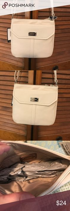 NWT Nine West Purse Brand New with tags. Never carried. Has outside flap with magnetic closure. There is a inside zipper in the main compartment.The strap is adjustable. Really cute! Just not big enough for my needs and I have too many bags. Nine West Bags Crossbody Bags