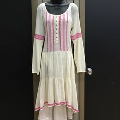 Free People High Low Embroidered Dress Embroidered design on front. Trim around High low. Long sleeved Free People Dresses High Low