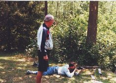 Shifty teaching Peter Youngblood Hills how to shoot.