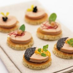 Appetizers amuse-bouche - pate and sesame seeds on a racker