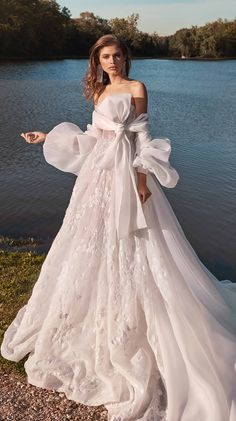 For the bride that doesn't want to compromise on her dream wedding dress - don't let the winter season stop you - add a cover up. This isn't about covering up your dress but more your skin, a wedding coverup should complement your bridal style rather than detract from it. If your style is more bohemian, the whimsical Galia Lahav #Meghan wedding is made even more romantic thanks to a matching a voluminous coat with balloon sleeves that fasten at the neckline.