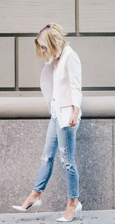 Jacey Duprie is wearing a white blazer from Helmut Lang, distressed jeans from Joe's Jeans and white shoes from Manolo Blahnik