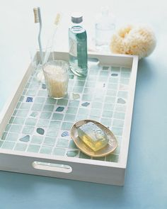 Sea-Glass-Tiled Tray or Tabletop How-To - Bits of sea glass introduce organic shapes to mosaic tiles in a tray or a geometric tile arrangement on a table. Because they're plentiful, bright bottle-green shards are ideal for large crafts.