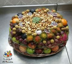 Get a beautiful carved Fruit Basket with nuts only on 350 AED.