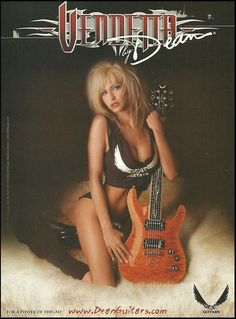 Could a beautiful woman wrapped around a guitar actually make you want the guitar? Or is it meant to simply grab your attention and look a little closer? Guitar Girl, Guitar Amp, Cool Guitar, Hard Rock, Dean Guitars, Girl Posters, Extreme Metal, Twist And Shout, Horror Show