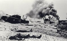 In the aftermath of the Dieppe Raid on August dead Canadian soldiers and abandoned Churchill tanks lie on the edge of rocky Blue Beach. One landing craft drifts while smoke pours from another hit by German fire during Operation Jubilee. Canadian Soldiers, Canadian Army, Canadian History, Fallen Soldiers, Churchill, Dieppe Raid, Battle Of Normandy, Rouen, Le Havre