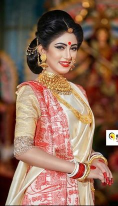 What a beautiful large low bun with beautiful ornamental  chain adornments! Care however should be taken before adopting such hairstyles, as due to it's high static charge, it will cause phlegm to move up in the throat, causing the voice to quaver & a frequent urge to clear the throat. A heavy chabi chhalla with a long & wide hook if inserted at the edge of the pleats of the saree, will reduce this problem as it's hook will activate the acupressure points that act to keep the throat clear.