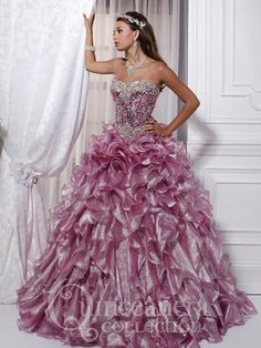 You'll feel like royalty in this sparkling House of Wu 26719 Quinceanera dress. It's perfect for the girl who wants to make an entrance at her party. Featuring a heart-shaped strapless neckline on a jewel encrusted corset bodice with boned princess seams. The princess cut ballroom style skirt cascades with large circular ruffles at the hips, softening into loose ruffles at the hem. The back laces up in true corset fashion.