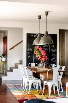 Loved this dining room, the table, chairs, lights, blackboard and amazing rug ... this home designed...