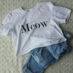 """Meow cropped tee Worn once. preshrunk cotton. 15"""" length. White with black lettering. Tops Crop Tops"""