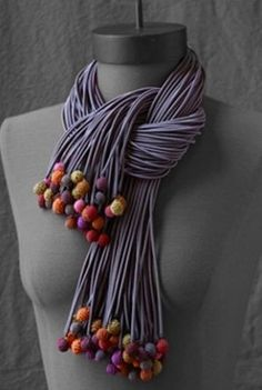 DIY t-shirt strips & polymer clay balls on ends. Love this look so dramatic.Valerie Barkowski nicer with FELTED balls!The most fabulous scarf Valerie Barkowskivalerie barkowski, fun textile jewelry and apparel on this site. Textile Jewelry, Fabric Jewelry, Clay Jewelry, Jewelry Art, Jewelry Design, Jewellery, Diy Scarf, Scarf Shirt, T Shirt Yarn