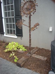 Cool piece of yard art made from old rail road spikes.