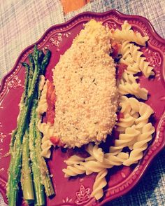 Skinny Chicken Parmesan over whole grain noodles with a side of Asparagus