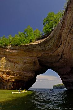 Sea kayakers at the Lovers Leap rock arch on Lake Superior at Pictured Rocks National Lakeshore near Munising Michigan Upper Peninsula.
