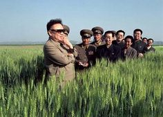 A propaganda picture of North Korea's reclusive leader Kim Jong-Il posed in a field of grain with a group of cadres in Pyongyang, Nov. Alex Webb, Kim Jong Il, New York Times Magazine, Kim Jung, Star Sky, Contemporary Photography, Magnum Photos, Bright Stars, Weird World