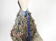 This upcycled gown is made from 1,000 recycled newspaper cranes.