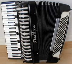 """Dallape Supermaestro - considered by many to be """"the"""" accordion for East European folk music. Piano Accordion, Folk Music, Percussion, Musical Instruments, Musicals, The Originals, Entertaining, Tattoos, Music Instruments"""