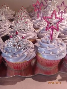 "Made these yummy cupcakes for my grandaughters  ""Sofia the First"" 2nd Birthday using tiaras,wands and edible pearls."